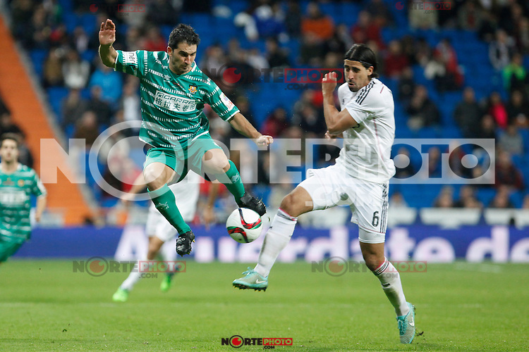 Real Madrid´s Sami Khedira (R) and Cornella´s Dani Marti duringSpanish King Cup match between Real Madrid and Cornella at Santiago Bernabeu stadium in Madrid, Spain.December 2, 2014. (NortePhoto/ALTERPHOTOS/Victor Blanco)