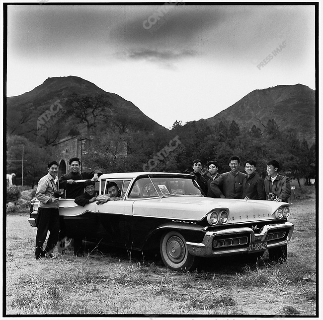 Li (second from the left) with eight former classmates from the Changchun Film School, during an outing in Beijing in a confiscated American-made Ford Mercury formerly used by Vice Premier and Foreign Minister Chen Yi and temporarily on loan to the rebel groups from Heilongjiang province (photographed with a self-timer). 16 October 1966.