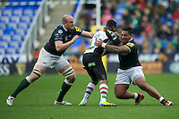 Ugo Monye of Harlequins is tackled by Halani Aulika (right) and Matt Garvey of London Irish during the Aviva Premiership match between London Irish and Harlequins at the Madejski Stadium on Sunday 28th October 2012 (Photo by Rob Munro)