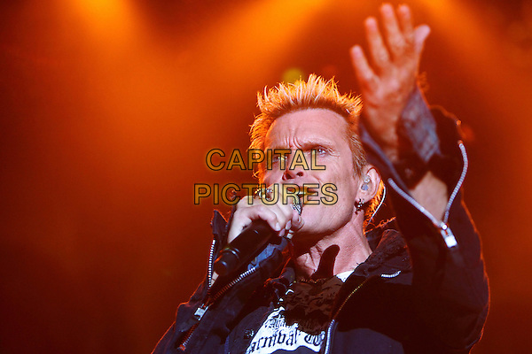 Billy Idol.Concert in Moscow, Russia..June 5th, 2010.stage concert live gig performance performing music in on half  length black leather jacket white top singing hand arm.CAP/PER/SB.©SB/PersonaStars/CapitalPictures