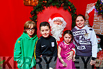 Sean Barry, Nathan O'Connor, Aoife and Aoibhan Begley with Santa in the John Mitchels GAA Complex on Saturday.