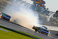 14 February, 2010, Daytona Beach, Florida USA USA.A.J. Allmendinger (#43) spins after hitting the wall exiting turn 2, narrowly missing Kyle Busch (#18)..©F. Peirce Williams 2010 USA.