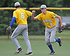 Paul Kooney #5, Kellenberg right fielder, right, gets congratulated by second baseman Jack Delaney after making a diving catch to end a St. Dominic rally and preserve the Firebirds' 4-3 lead in the bottom of the sixth inning of the CHSAA varsity baseball semifinals at Farmingdale State College on Tuesday, May 24, 2016. Kellenberg went on to win 5-3.