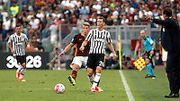 Calcio, Serie A: Roma vs Juventus. Roma, stadio Olimpico, 30 agosto 2015.<br /> Juventus&rsquo; Stephan Lichsteiner, right, is challenged by Roma&rsquo;s Lucas Digne during the Italian Serie A football match between Roma and Juventus at Rome's Olympic stadium, 30 August 2015.<br /> UPDATE IMAGES PRESS/Isabella Bonotto