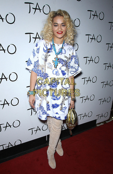 Rita Ora.Rita Ora hosts at Tao Nightlcub inside the Venetian Resort Hotel and Casino, Las Vegas, NV., USA..March 23rd, 2013.full length blue white floral print dress turquoise necklace beige suede knee high thigh otk over boots gold clutch  bag purse skulls skull.CAP/ADM/MJT.© MJT/AdMedia/Capital Pictures.