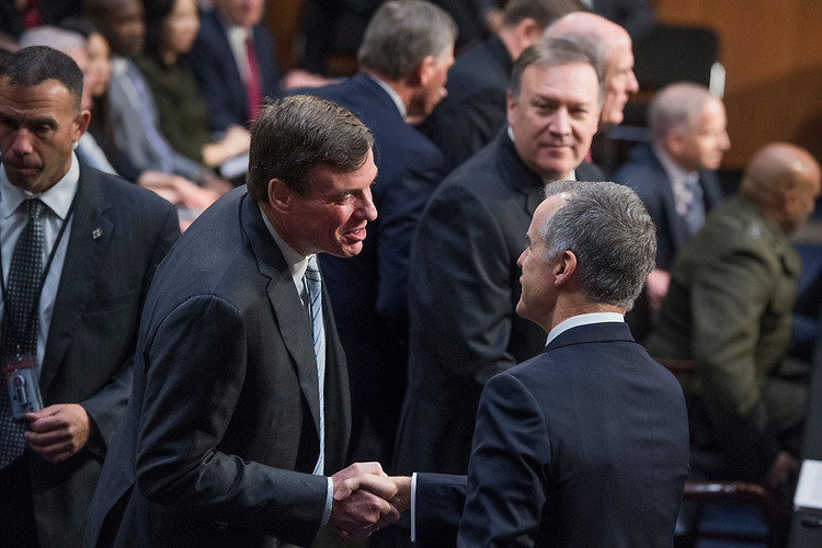 "UNITED STATES - MAY 11: Ranking Member Mark Warner, D-Va., left, greets acting FBI Director Andrew McCabe, before a Senate (Select) Intelligence Committee hearing in Hart Building titled ""World Wide Threats"" on May 11, 2017. (Photo By Tom Williams/CQ Roll Call)"