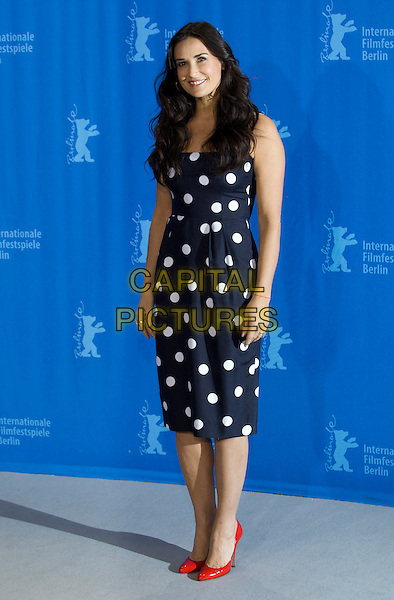 "DEMI MOORE.Photocall for ""Happy Tears"" during Berlinale 2009, 59th  Berlin International Film Festival, Berlin, Germany..February 11th, 2009.full length blue white red shoes polka dot dress black.CAP/PPG/JH.©Jens Hartmann/People Picture/Capital Pictures"
