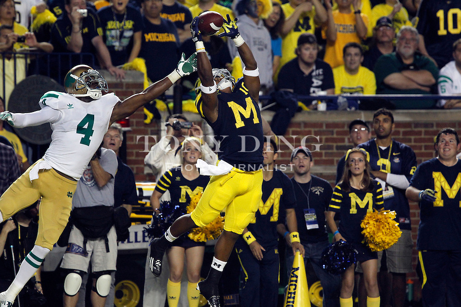 Notre Dame cornerback Gary Gray (4) fails to defend a 14-yard touchdown reception by Michigan wide receiver Jeremy Gallon (10) in the fourth quarter of an NCAA college football game, Saturday, Sept. 10, 2011, in Ann Arbor. Michigan won 35-31. (AP Photo/Tony Ding)