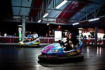 "A young couple  in their bumper car in Basraland a recently opened amusement park in the southern Iraqi city of Basra. .From ""Yesterday's War, Today's Iraq,"" an ongoing series documenting Iraq and Iraqis as US forces withdraw from the country and media interest wanes. ."