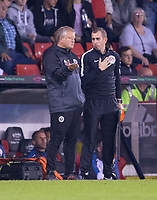 Sheffield United manager Chris Wilder talks to fourth Offical Peter Bankes after Referee Tony Harrington doesn't show Islam Slimani of Leicester City a second yellow card during the Carabao Cup match between Sheffield United and Leicester City at Bramall Lane, Sheffield, England on 22 August 2017. Photo by James Williamson / PRiME Media Images.