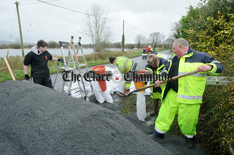 Clare County Council workers and locals fill sand bags as Springfield, Clonlara residents prepare for flooding due to water being released at the Parteen Weir. Photograph by John Kelly.
