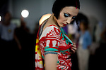 A model practices her walk before hitting the runway, backstage for the Brazilian brand, Neon, at São Paulo Fashion Week for Summer Season 2013/2014, at Bienal, in São Paulo, Brazil, on Wednesday, March 20, 2013.