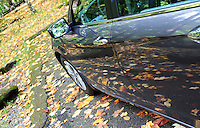 Stock photo: Car parked in forest with fall leaves lying around and their reflection in the car body, in the great smoky mountains national park in autumn.