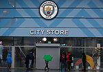 Fans look into the closed club shop after the Premier League match between Manchester City and West Ham United was postponed because of weather conditions at the Etihad Stadium, Manchester. Picture date: 9th February 2020. Picture credit should read: Darren Staples/Sportimage