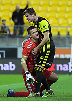 Alex Rufer congratulates Filip Kurto after Sydney's missed penlaty during the A-League football match between Wellington Phoenix and West Sydney Wanderers at Westpac Stadium in Wellington, New Zealand on Sunday, 17 March 2019. Photo: Dave Lintott / lintottphoto.co.nz