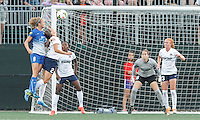 Allston, Massachusetts - August 8, 2015: In a National Women's Soccer League (NWSL) match, Boston Breakers (blue) defeated Washington Spirit (white/black), 2-1, at Soldiers Field Soccer Stadium.<br /> Julie King scores with a header.