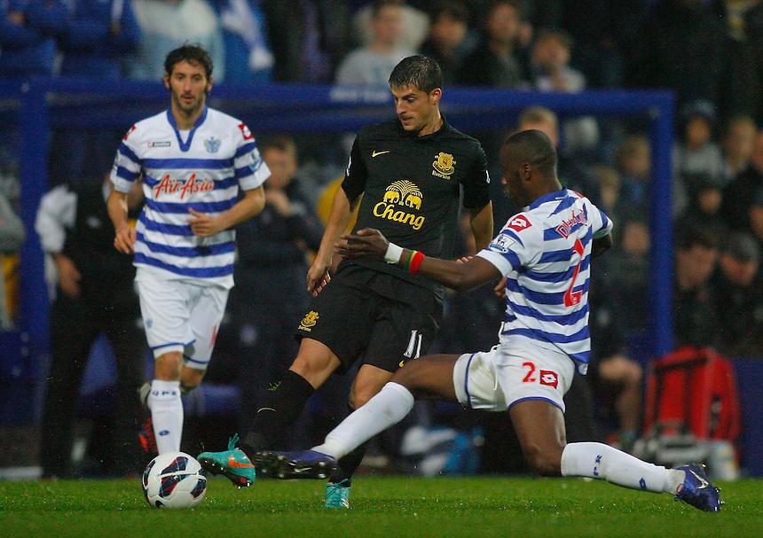 Everton's Kevin Mirallas is tackled by Queens Park Rangers' Samba Diakite ..Football - Barclays Premiership - Queens Park Rangers v Everton - Sunday 21st October 2012 - Loftus Road - London..