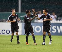 Dwayne De Rosario (7) of D.C. United celebrates his goal with teammate Clyde Simms (19) during the game at RFK Stadium in Washington, DC.  D.C. United tied Toronto FC, 3-3.