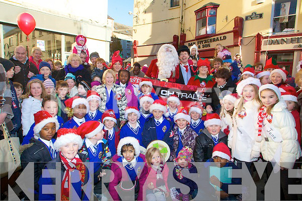 BAND: Santa meets up with the children from CBS Clounalour School, in the Square Tralee on Saturday, who entertained the large crowd who met up with Santa............................ ..........