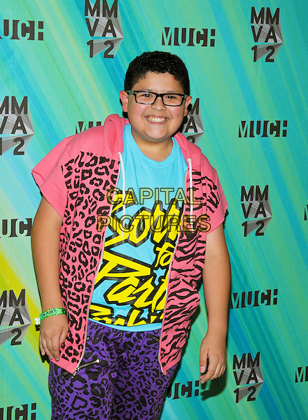 Rico Rodriguez poses in the press room at the 23rd Annual MuchMusic Video Awards at the MuchMusic HQ, Toronto, Ontario, Canada. .June 17th, 2012.half length pink blue purple leopard print shirt top glasses  .CAP/ADM/BPC.©Brent Perniac/AdMedia/Capital Pictures.