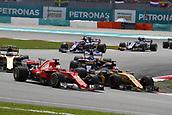 1st October 2017, Sepang, Malaysia;  FIA Formula One World Championship, Grand Prix of Malaysia, 5 Sebastian Vettel (GER, Scuderia Ferrari), 27 Nico Hulkenberg (GER, Renault F1 Team), Sepang Malaysia