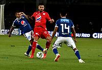 BOGOTÁ - COLOMBIA, 18-01-2019: Jhon Duque (Izq.) y David Macalister Silva (Der.) jugadores de Millonarios disputan el balón con Julián Guevara (Cent.) jugador de América de Cali, durante partido entre Millonarios y América de Cali, por el Torneo Fox Sports 2019, jugado en el estadio Nemesio Camacho El Campin de la ciudad de Bogotá. / Jhon Duque (L) and David Macalister Silva (R) players of Millonarios struggle for the ball with Julián Guevara (C) player of America de Cali,  during a match between Millonarios and America de Cali, for the Fox Sports Tournament 2019, played at the Nemesio Camacho El Campin stadium in the city of Bogota. Photo: VizzorImage / Luis Ramírez / Staff.
