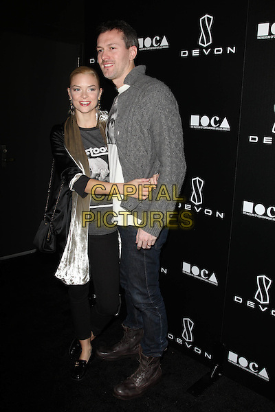 JAIME KING & KYLE NEWMAN .Grand Opening Of Devon Flagship Store in Beverly Hills held At Devon Store, Beverly Hills, CA, USA, .8th December 2010..full length silver scarf t-shirt grey gray  jaime velvet jacket knitted cardigan jeans arms around hug hugging .CAP/ADM/KB.©Kevan Brooks/AdMedia/Capital Pictures.