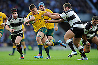 Sean McMahon of Australia breaks in midfield to score a try during the Killik Cup match between Barbarians and Australia at Twickenham Stadium on Saturday 1st November 2014 (Photo by Rob Munro)