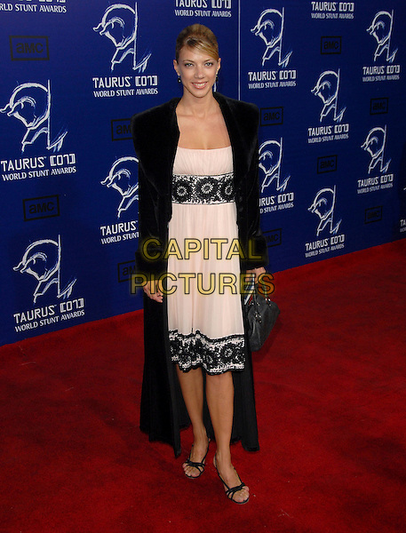 YOULIA GOLENKA.The 2007 Taurus Stunt Awards held at Paramount Studios in Hollywood, California, USA..May 20th, 2007.full length black coat jacket pink cream dress detail floral bag purse .CAP/DVS.©Debbie VanStory/Capital Pictures