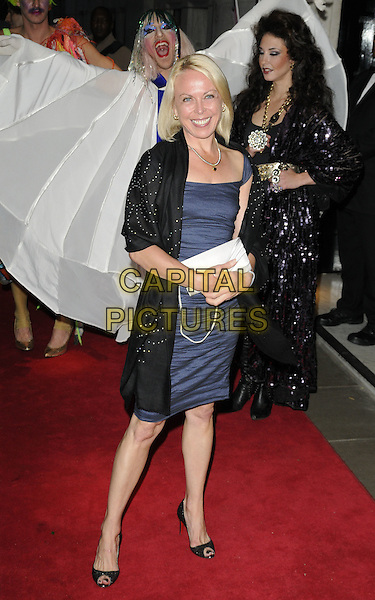JAYNE TORVILL.Freddie For A Day charity gala arrivals, Savoy hotel, the Strand, London, England..September 5th, 2011.full length black wrap shawl blue silk satin dress silver clutch bag.CAP/CAN.©Can Nguyen/Capital Pictures.