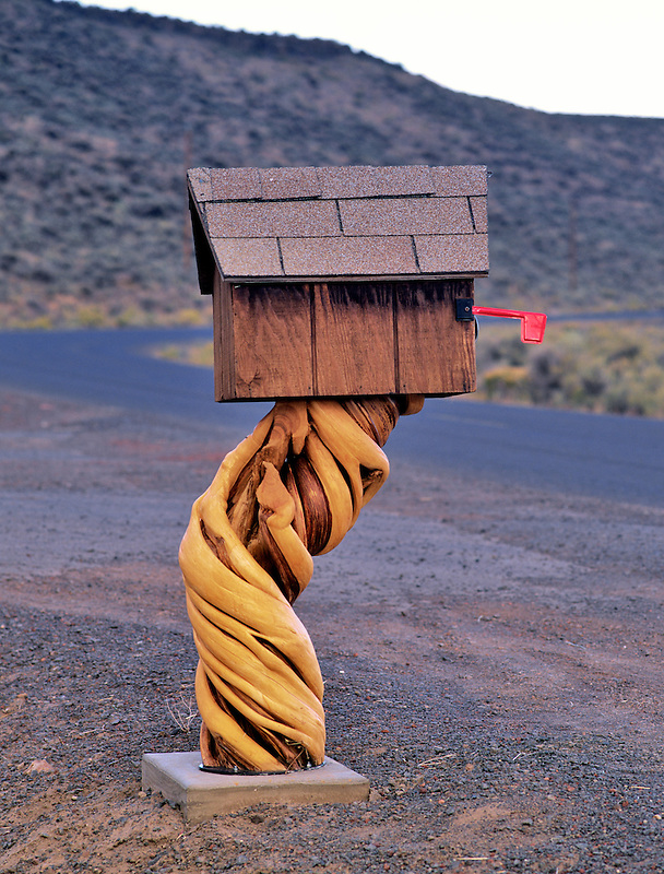 Mailbox with post of twisted tree. Harney County, Oregon.