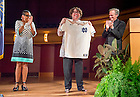 Sept. 2, 2015; University of Notre Dame president, Rev. John I. Jenkins, C.S.C. and Judge Ann Williams applaud with the audience as U.S. Supreme Court Justice Sonia Sotomayor holds up her special gift, a Notre Dame Fighting Irish Replica Baseball Jersey from Fr. Jenkins at the close of her talk in the Leighton Concert Hall of the DeBartolo Performing Arts Center. (Photo by Barbara Johnston/University of Notre Dame)