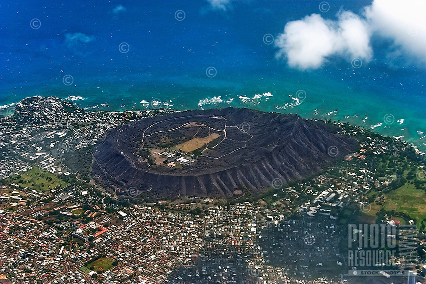 Aerial view of world-famous Diamond Head, surrounded by the  Pacific Ocean and Gold Coast neighborhoods on O'ahu