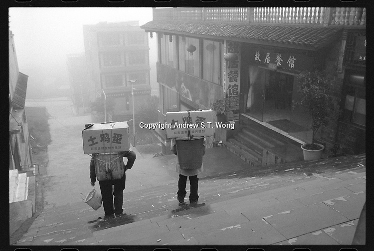 Villagers carry boxes of eggs at Xingyi, Guizhou Province, 2018.