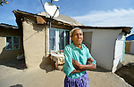 Necmie Ahmed, 67, in front of her home in a largely Roma, Turkish-speaking neighborhood of Dobrich, in the northeast of Bulgaria.