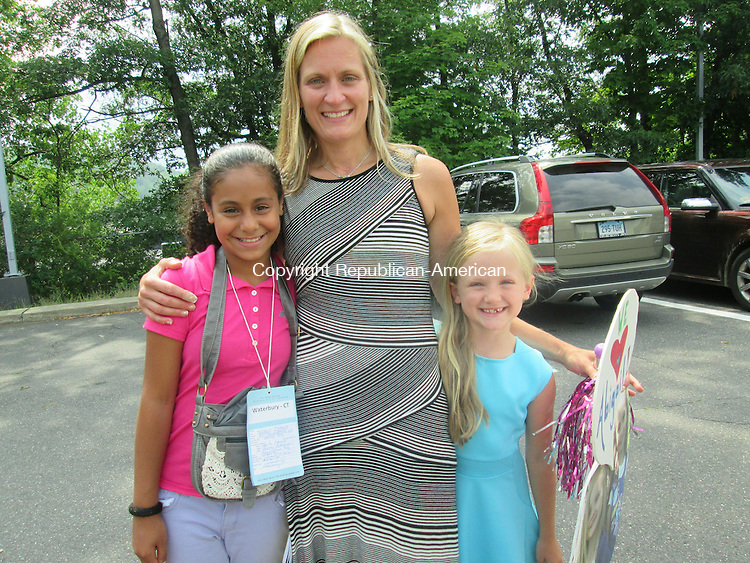 WATERBURY,CT- 06 July 2015- 070615DL02-- Abigail Cabrera, left, stands with her host family, Kathleen Reidy, center, and Lucy Reidy, right. Cabrera has been spending part of her summer with the Reidy family for four years. Destiny Lopez Republican-American