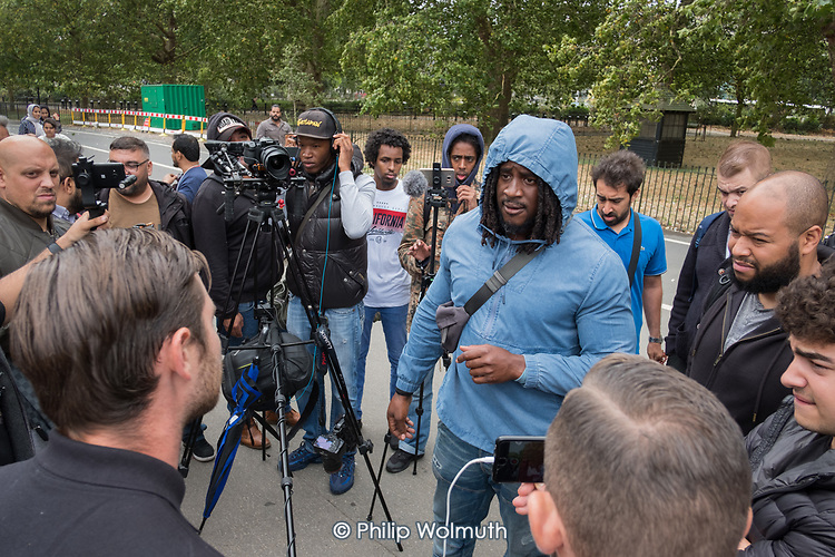 Speakers' Corner, Hyde Park, London, where the use of video cameras and smartphones to record speakers, preachers, sermons and arguments, for broadcast via social media, has become widespread in recent months.