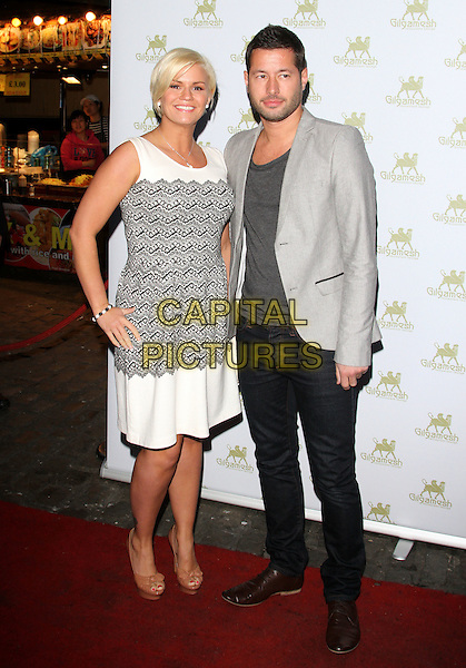 Kerry Katona & Steve Alce.Amy Childs' SS12 Clothing Collection Launch at the Gilgamesh Bar - Arrivals..London, England..March 19th, 2012.full length white black grey gray print dress suit jacket jeans denim couple hand on hip sleeveless.CAP/ROS.©Steve Ross/Capital Pictures