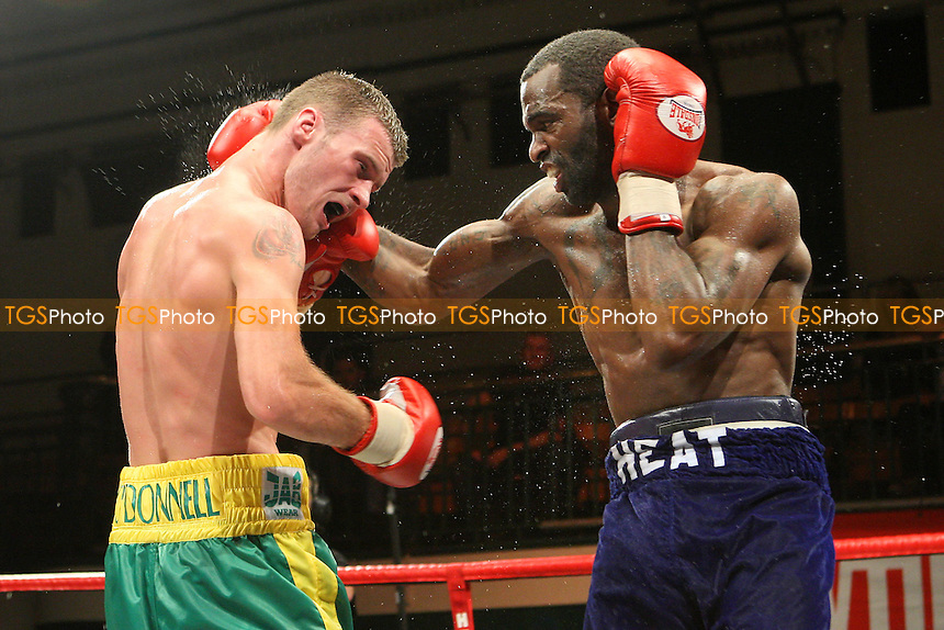 John O'Donnell (green/yellow shorts) defeats Terrance Cauthen in a Welterweight boxing contest at York Hall, Bethnal Green, promoted by Hennessy Sports / Shobox: The Next Generation - 10/09/10 - MANDATORY CREDIT: Gavin Ellis/TGSPHOTO - SELF-BILLING APPLIES WHERE APPROPRIATE. NO UNPAID USE. TEL: 0845 094 6026