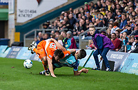 Jack Payne of Blackpool pulls Luke O'Nien of Wycombe Wanderers to ground during the Sky Bet League 2 match between Wycombe Wanderers and Blackpool at Adams Park, High Wycombe, England on the 11th March 2017. Photo by Liam McAvoy.