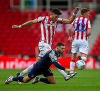 4th July 2020; Bet365 Stadium, Stoke, Staffordshire, England; English Championship Football, Stoke City versus Barnsley; Conor Chaplin of Barnsley is tackled