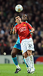 Manchester United's Carlos Tevez and Barcelona's Yaya Toure during the Champions League semi-final 2nd leg match at Old Trafford, Manchester. Picture date 29th April 2008. Picture credit should read: Simon Bellis/Sportimage