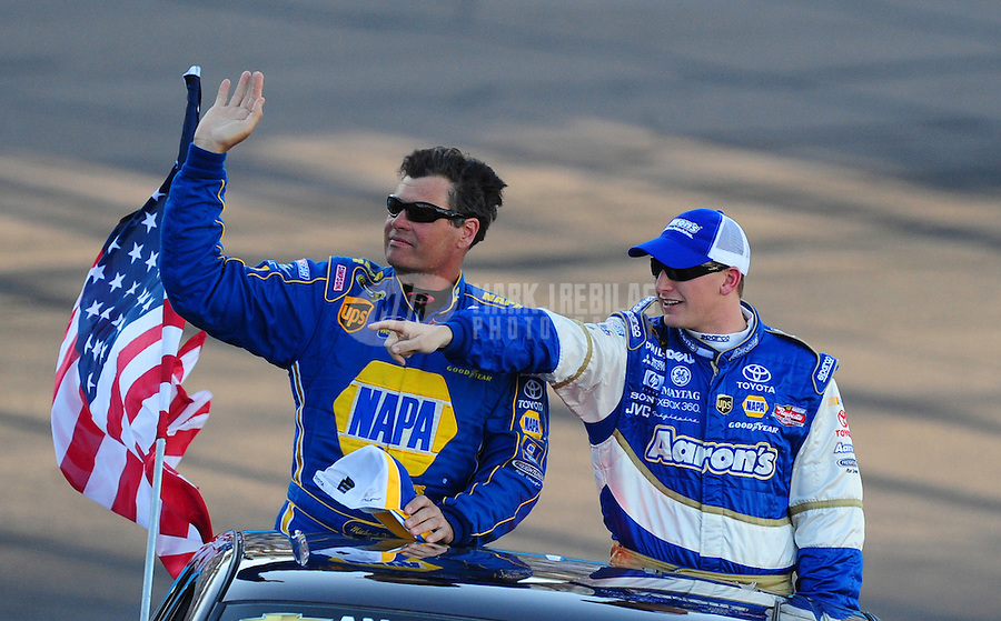Apr 12, 2008; Avondale, AZ, USA; NASCAR Sprint Cup Series driver Michael Waltrip (left) and teammate Michael McDowell during the Subway Fresh Fit 500 at Phoenix International Raceway. Mandatory Credit: Mark J. Rebilas-
