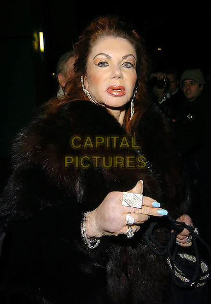 JACKIE STALLONE.The British Comedy Awards AfterParty, London..UK, United Kingdom.14th December 2005.Ref: CAN.portrait headshot brown fur jacket coat heavy make-up diamond dangly earrings plastic surgery jewellery rings fingers fingernails blue nail varnish.www.capitalpictures.com.sales@capitalpictures.com.©Capital Pictures