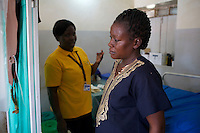 UNFPA South Sudan supports human capacity building in the health sector. UNV performing a check-up of a pregnant woman at Muniki health centre in the maternity unit. She assists future mothers during their pregnancy.