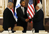 New York, NY - September 22, 2009 -- United States President Barack Obama (C) shakes hands with  Palestinian President Mahmoud Abbas (R) as Israeli Prime Minister Benjamin Netanyahu looks on, at a trilateral meeting at the Waldorf Astoria Hotel in New York City on Tuesday, September 22, 2009.  .Credit: John Angelillo / Pool via CNP
