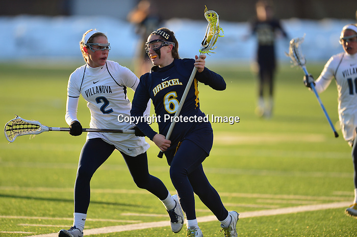 PHILADELPHIA - The Drexel women's lacrosse team got two goals from senior Kelly Palace, but could not overcome an early 5-0 deficit as the Dragons fell at Villanova, 9-5. The Dragons were held scoreless for the first 29:58 of play before getting on the board with two seconds remaining in the first half.<br /> <br /> The Dragons (2-3) won just one of the first six draw controls of the game, giving the Wildcats extra opportunities to build up their 5-0 lead. Just before halftime, though, senior Amanda Norcini drew a foul and earned a free position shot, converting to put Drexel on the board.<br /> <br /> Villanova extended its lead to 7-1 over the first eight minutes of the second half before the Drexel comeback effort got going in earnest. Palace notched her first goal of the day with 18:45 remaining, taking a feed from Joelle Hartke and beating Villanova goalie Jaclyn Fraum.<br /> <br /> After the Wildcats scored one more to make it 8-2, Drexel tallied a flurry of goals to make Villanova uncomfortable in the closing minutes of play. It began when draw control specialist Milan White got a free position look and made it count with 7:52 to play. Just 23 seconds later, Caroline Thiele scored her third goal of the season, unassisted, to make it an 8-4 game.<br /> <br /> Villanova held Drexel at bay for the next three minutes, but Palace notched another free position goal with 3:15 remaining, pulling the Dragons within three. The goal was the team-leading tenth of the season for Palace, leaving her tied with Andi Raymond of Towson for second in the Colonial Athletic Association.<br /> <br /> That would be as much as Drexel could muster, as the Wildcats added a late goal to cap off the victory. Drexel will now return home for the first time in March as they host UMBC on Saturday afternoon at 1:00 p.m.