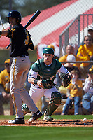 Dartmouth Big Green catcher Adam Gauthier (18) checks the runner after blocking a pitch with Nick Roscetti (3) batting during a game against the Iowa Hawkeyes on February 27, 2016 at South Charlotte Regional Park in Punta Gorda, Florida.  Iowa defeated Dartmouth 4-1.  (Mike Janes/Four Seam Images)