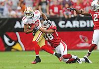 Sept. 13, 2009; Glendale, AZ, USA; San Francisco 49ers wide receiver (83) Arnaz Battle is tackled by Arizona Cardinals safety (49) Rashad Johnson at University of Phoenix Stadium. San Francisco defeated Arizona 20-16. Mandatory Credit: Mark J. Rebilas-