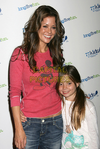 BROOKE BURKE & DAUGHTER NERIAH .77kids Launch Party Clothing Line by American Eagle hosted by the Jonas Brothers held at The Roxy, Los Angeles, California, USA, 14th November 2008..half length red mickey mouse top t-shirt mother family child kid  jeans .CAP/ADM/MJ.©Michael Jade/Admedia/Capital Pictures